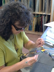 Bead instructor, Marie Taylor,  demonstrating how to make glass beads at db Studio at Barnard Griffin Winery